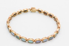14Kt Gold Tennis Bracelet Decorated with Opal Gemstones